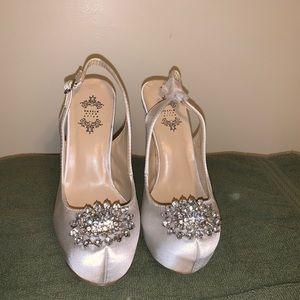 Satin white platform sling back heels.